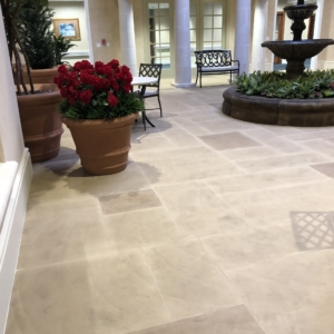 limestone overlay used in commercial entryway